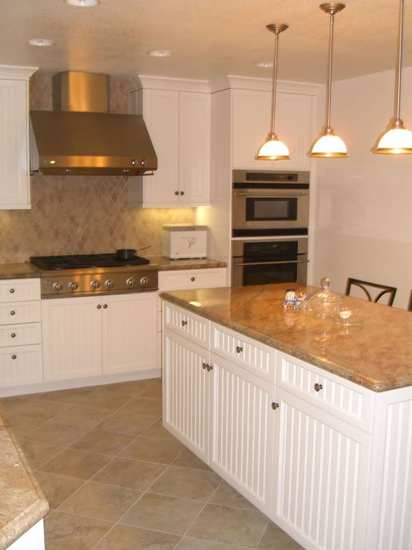 White kitchen cabinets travertine tile floors for the for White kitchen cabinets with tile floor
