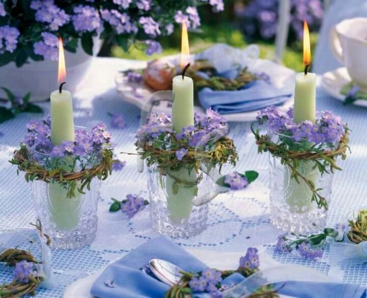 Jelly jars with simple purple flowers and greenery with a candle