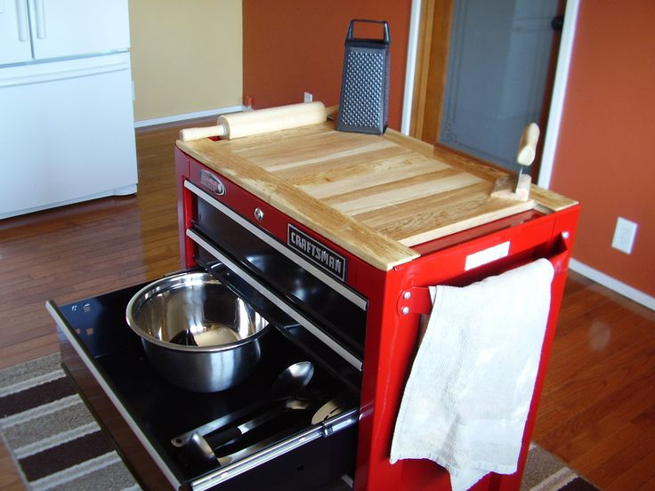 Tool box repurposed for kitchen center island.  Wooden table top is hand made tongue and groove oak.  Side strips hold a rolling pin.