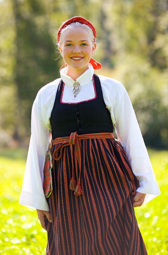 Bodice skirt and traditional striped woollen apron. Järvsö, Hälsingland, Sweden Photo: Laila Durán