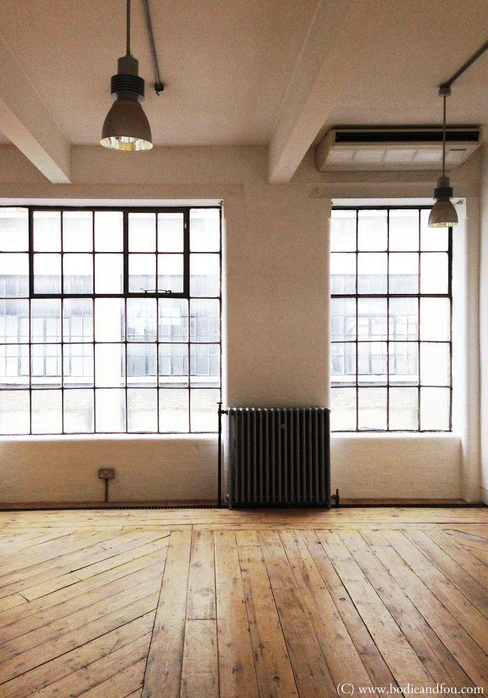 Wood floors, industrial windows, pendants, natural, wood, black, white // studio space