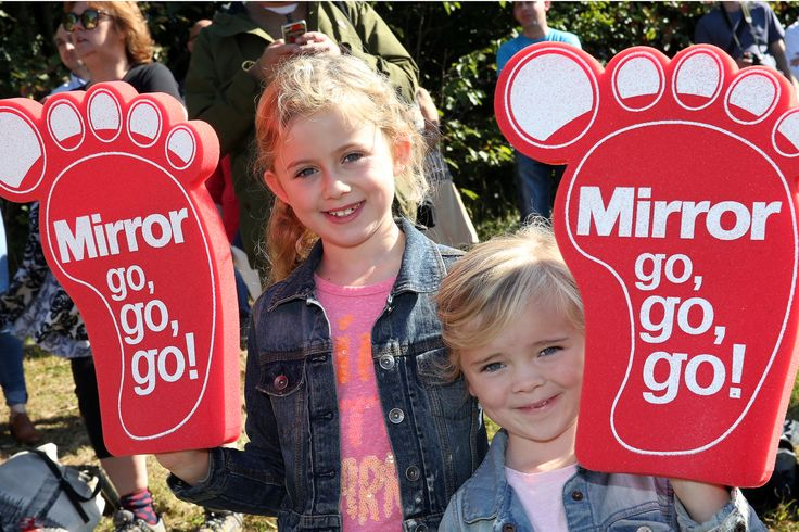 Great North Run 2014 Children watching with Daily Mirror sponsored foam feet to wave at runners.