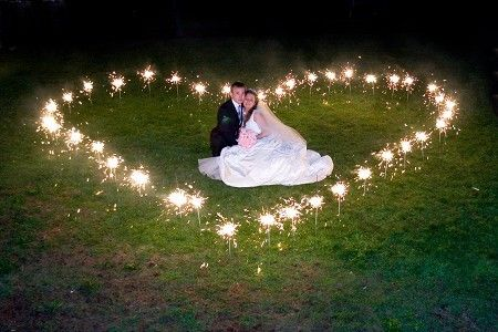 Any picture with a sparkler would be cute for the bride and groom.