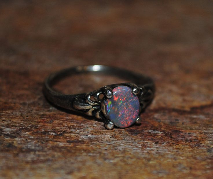 Genuine! .45ct. Lightning Ridge Black Opal Ring in Sterling Silver by LeapingLemurBaubles on Etsy https://www.etsy.com/listing/192346040/genuine-45ct-lightning-ridge-black-opal