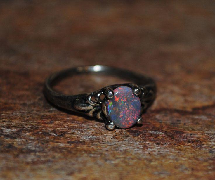 Genuine! .45ct. Lightning Ridge Black Opal Ring in Sterling Silver by LeapingLemurBaubles on Etsy https://www.etsy.com/listing/192346040/genuine-45ct-lightning-ridge-black-opal