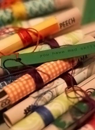 Especially for National Poetry Month - make little scrolls wrapped in scrapbooking paper and ribbon, with a little pocket/scroll poem inside.