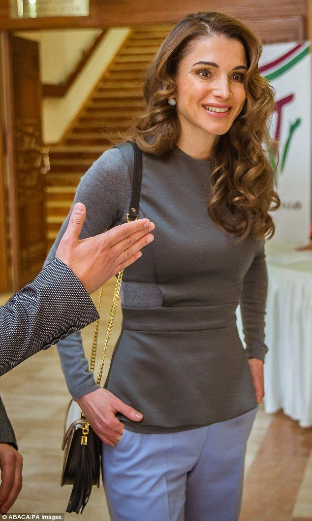Queen Rania of Jordan looked sharp as she stepped out to meet young volunteers in Amman on...