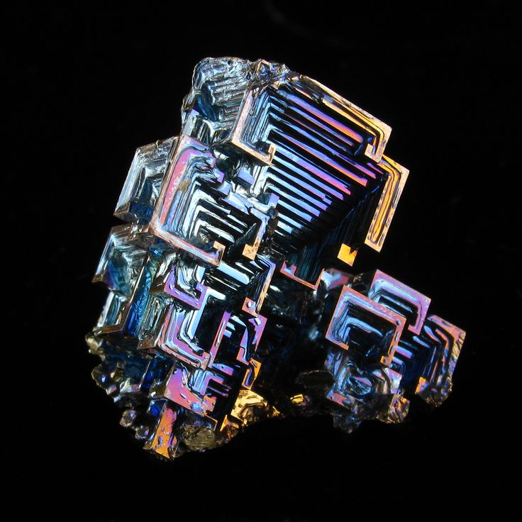 https://flic.kr/p/wFzMyD | Bismuth Crystal | A close-up of a small bismuth crystals, 40 mm. The crystal gets its colours from a thin layer of bismuth oxide.   I have used my improved photo studio, which allows for a full black background. No photo editing was done except for the removal of some reflections on the glass plate underneath the crystal.