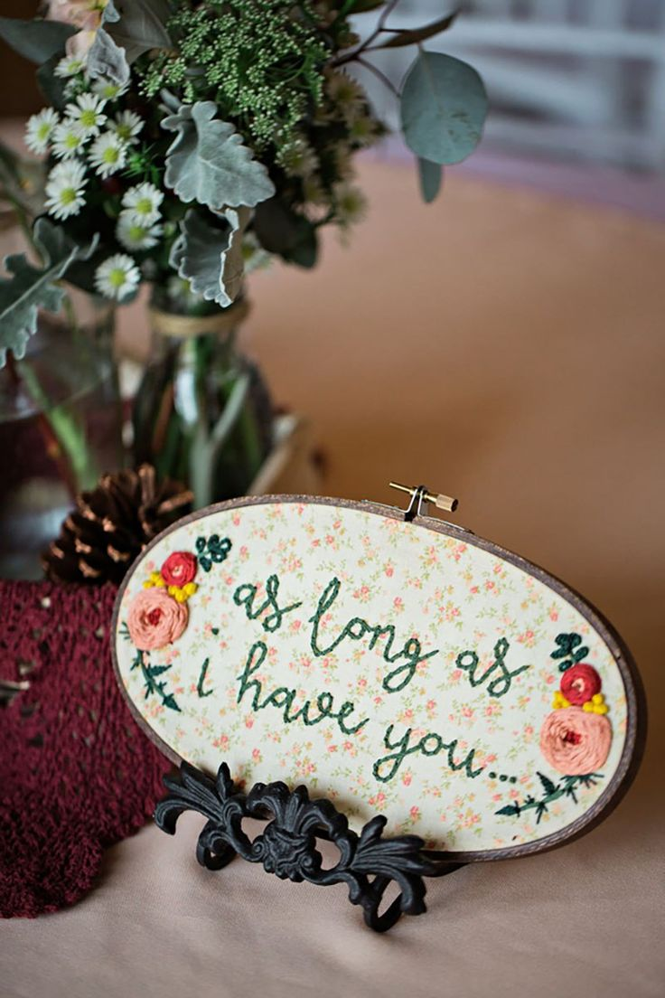 Embroidery, lush bouquets, and a steak cake -- this wedding is stitched onto our hearts