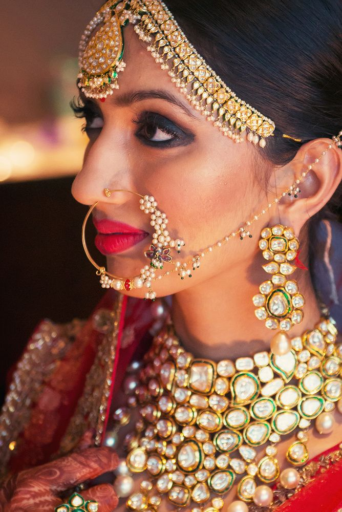 Real Indian Weddings - Anushree and Rishab | WedMeGood | Bridal Portrait of the Bride in a Polki Choker Necklace with a Gold and Pearl Matha Patti and a Delicate Pearl  Nath Picture Courtesy: Dhanika Choksi Photography #wedmegood #polki #realwedding #jewelry