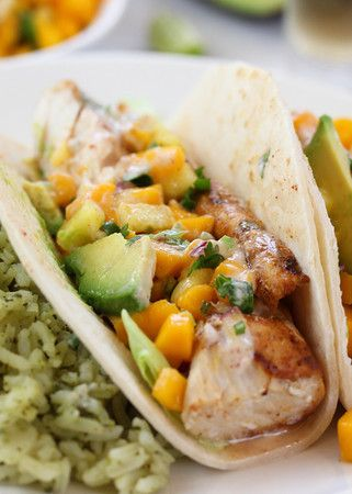 Grilled Mahi Mahi Fish Tacos with Mango Pineapple Salsa...previous pinned said: i put too much lime juice in the crema, but added some garlic salt to try to balace it out. my mangos werent ripe and i wanted to add corn but i forgot. also used spinich and not cabbage, and forgot the avocado. very easy recipe!!