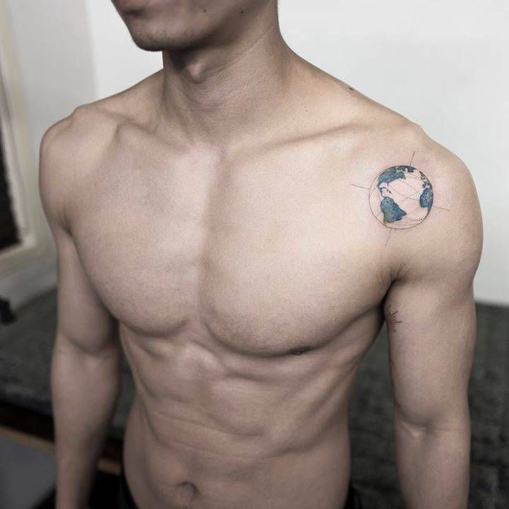 Planet Earth tattoo on the left shoulder. Tattoo artist: Ilwol Hongdam