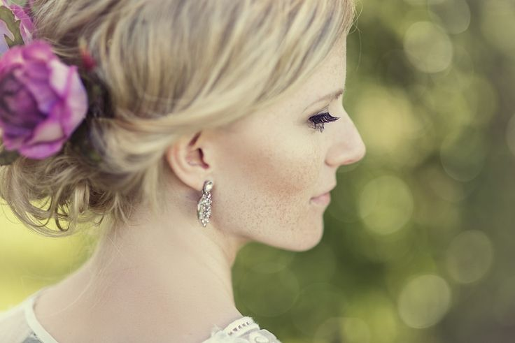 Beautiful bride portrait, blonde bride hair with roses