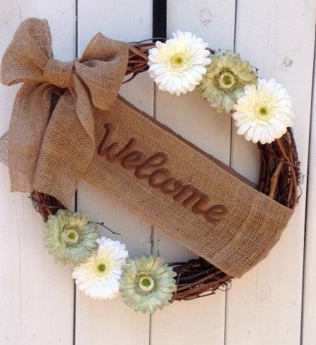 This Beautiful Hand Crafted Wreath is an 18 grapevine wreath adorned with gorgeous mint green and cream gerber daisies and a burlap welcome