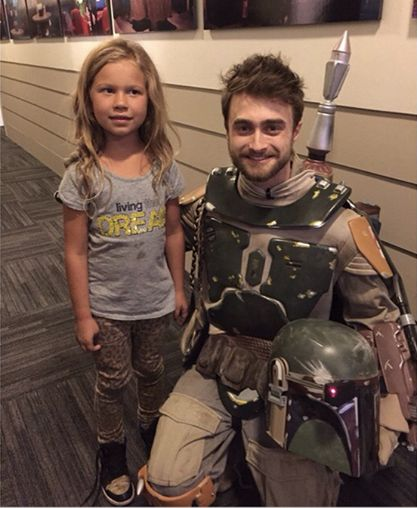 "Love the look on the little girl's face: ""why is Harry Potter dressed like Boba Fett?"""