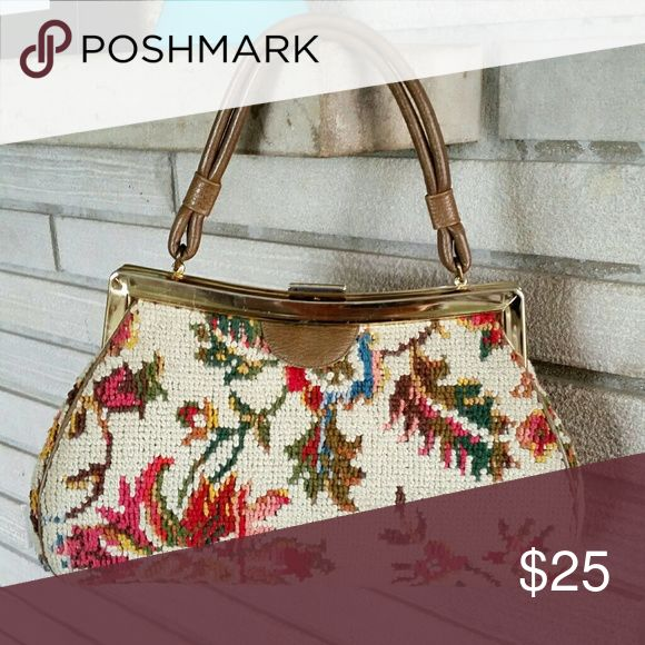"Dova USA Vintage Handbag Tapestry Needlepoint DOVA USA Vintage 50's midcentury handbag Tan Tapestry Needlepoint w/ Floral Print. Spilene Flower Floral Pattern. Brown leather strap in excellent condition. Gold clip on closure. There are some stains on the gold. See pics. Other than that purse is in excellent used condition. No stains, rips or snags on body or interior of purse.  Height 7.5"" Width 11.5"" Strap drop 5.5"" Bottom length 11.5"" Bottom width 4.6"" Dova USA Bags"