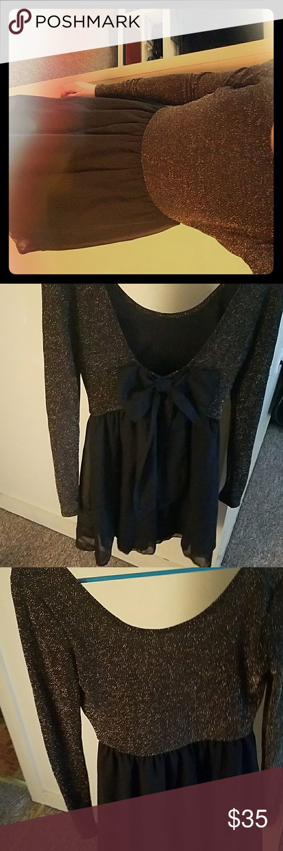 Gold sparkly dress Gold and black dress. Very flirty and has an adorable bow on the back!! Worn once! Deb Dresses