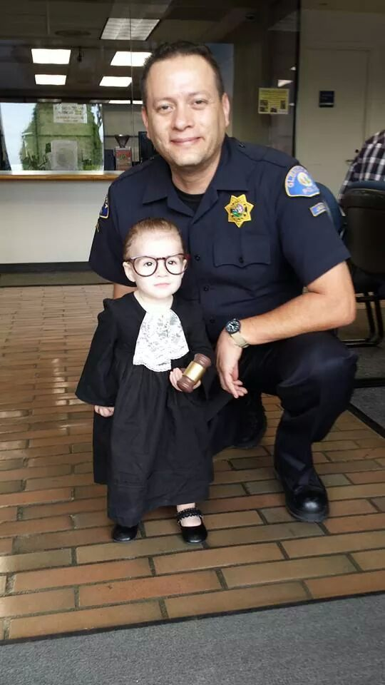 My friends daughter dressed as Supreme Court Justice Ruth Bader Ginsberg, along with her Bailiff for Halloween.
