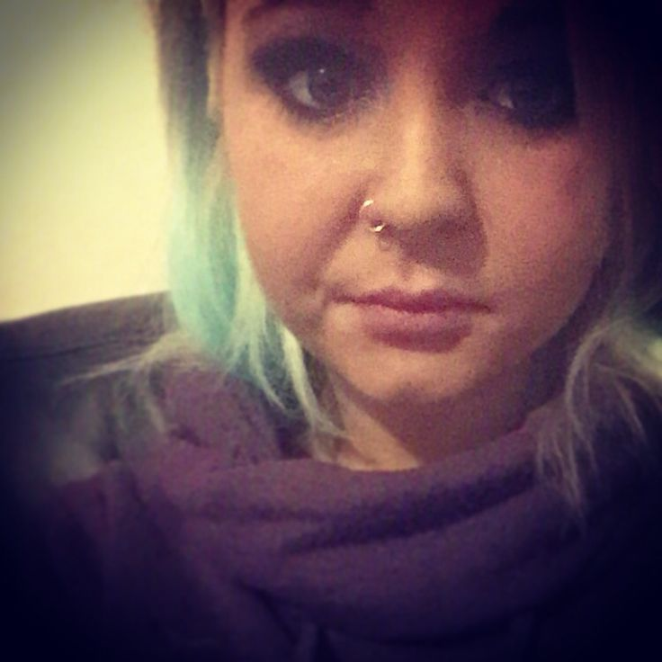 Nose piercing and blue hair