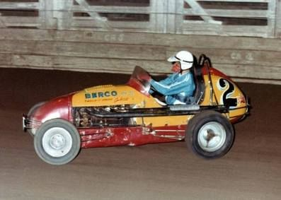 """talented Howard Revell pilots the Eddie Dark owned """"big"""" Berco midget around the Sydney Showground speedway. The car had a long career and was originally in the hands of """"Satan"""" Brewer."""