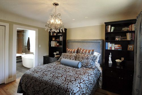 I like the tall book cases....Small Master Bedroom Decorating Ideas   Small Master Bedroom Decorating Ideas To Look Bigger