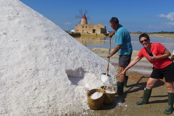 "Harvesting salt at the Marsala Salt Flats - One of the excursions on Culture Discovery Vacations' ""Cooking & Adventure on the Islands of Sicily"" cooking, culinary and wine tours in Italy. http://www.culturediscovery.com/sicily-italy-cooking-vacation/cooking-a-adventure-on-the-islands-of-sicily.html"