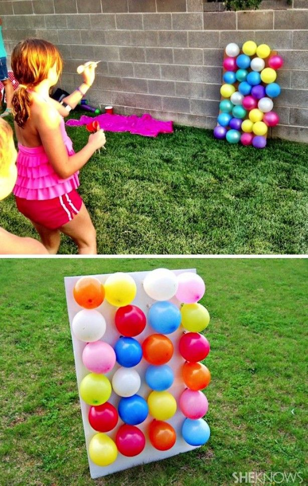 Great children's outdoor birthday game: darts with balloons! Throw arrows at balloons in order to hit them