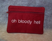 Oh Bloody Hell  Tampon & Maxi Pad BLUE Taxi Zippered Fabric Purse Pouch / Tampon Keeper. $11.95, via Etsy.