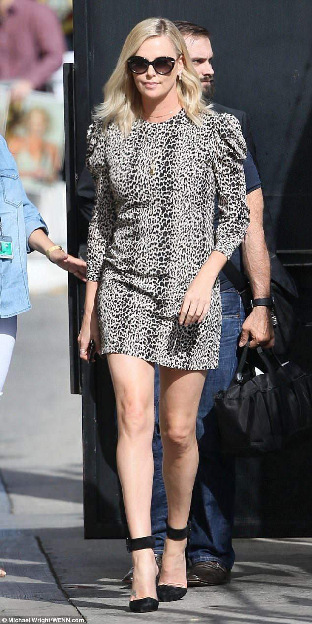 Stylish: The statuesque blonde, 41, headed to the show's Hollywood studio on Thursday in the patterned black and white number that featured long sleeves
