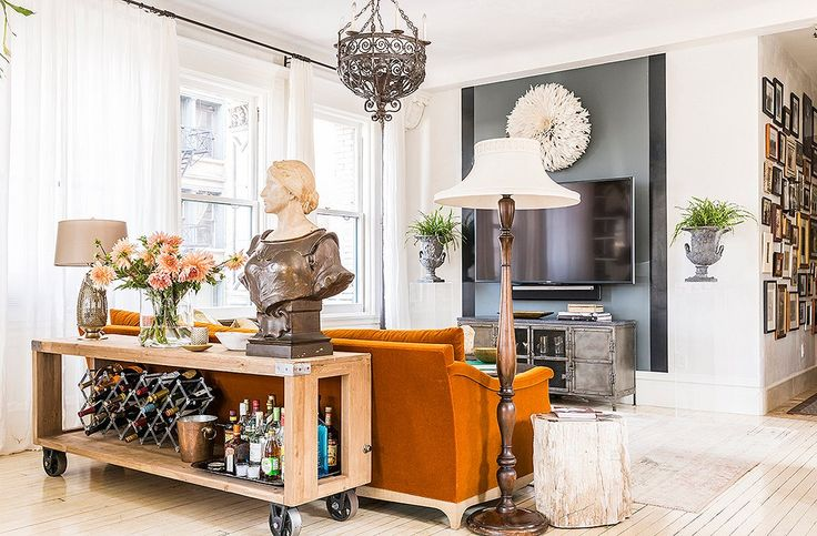 To downplay the TV in the family's seating nook, Katie turned to one of her favorite decorating tricks: a glossy stripe of black paint.