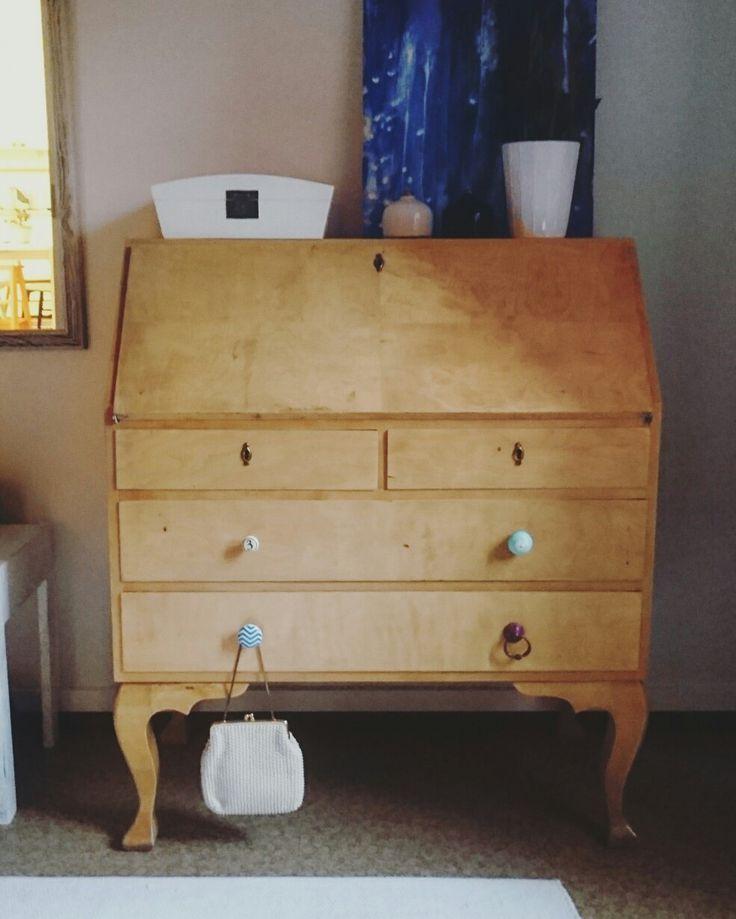 Old dresser made of birch, new knobs.
