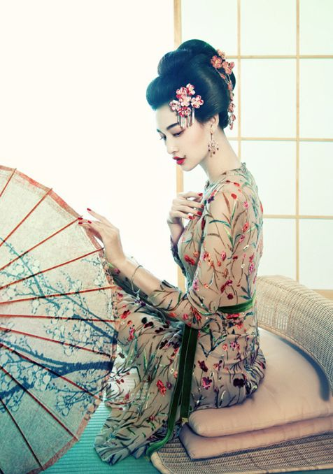 Glamorous Asian-inspired look. Sheer dress with elegant floral embroidery & green velvet sash.