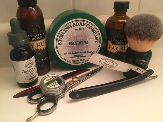 Pre-shave oil: Oscar's Oil Signature (Bay Rum) Shaving soap: Stirling Soap Company Bay Rum After shave balm: Captain's Choice Bay Rum Aftershave splash: Captain's Choice Bay Rum Straight razor: George Wostenholm & Son Original Pipe Razor (vintage) Shaving brush: Stirling 26mm synthetic (new) Straight razor honing: comfortable Jnat edge by ricky2sharp Moustache wax: Beards by Design Survivor  Moustache scissors: Urban Beard Moustache comb: Urban Beard
