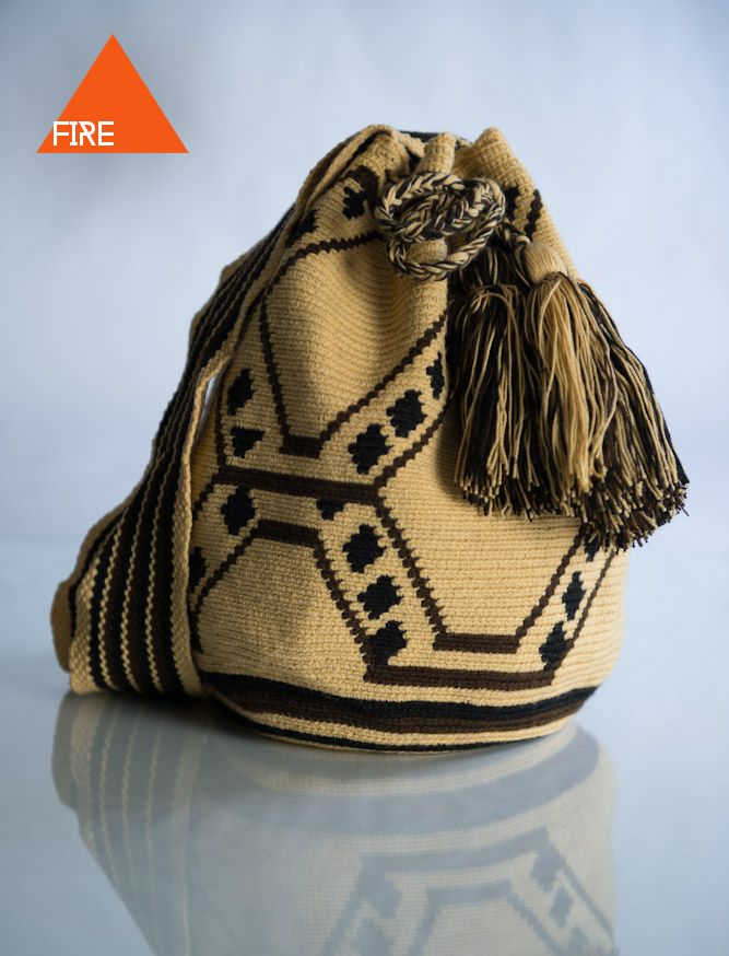 COMOCHI Bags   Handmade Bohemian Bags, $119.00 Tuikii(Fire) Boho Bags are woven by two strands of thread, taking 7-10 days to weave. Weather your out on the town or hanging by the beach this accessory is perfect for any occasion. Handmade in Colombia by the indigenous Wayuu people.  www.comochibags.com