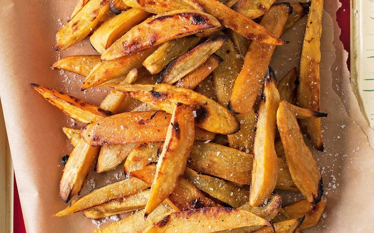 Oven-baked kumara chips recipe - By FOOD TO LOVE, Put a healthy swing on hot chips with these beautiful home-baked kumara chips. We've used sweet potato in this recipe to lower the starch content, but maximise flavour. Enjoy!