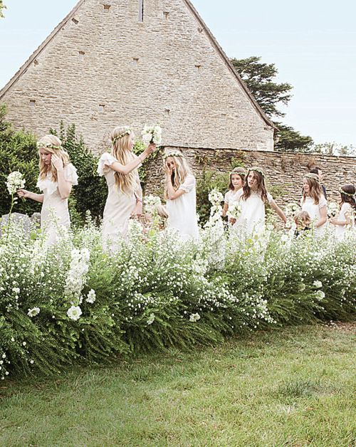 Kate Moss's version of the bridal party: a bohemian rhapsody with a little dash of Paris in the '20s. A kind of rock 'n roll forest nymph look that I find divine.