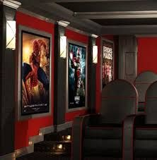 Pictures of home movie theaters with movie posters.