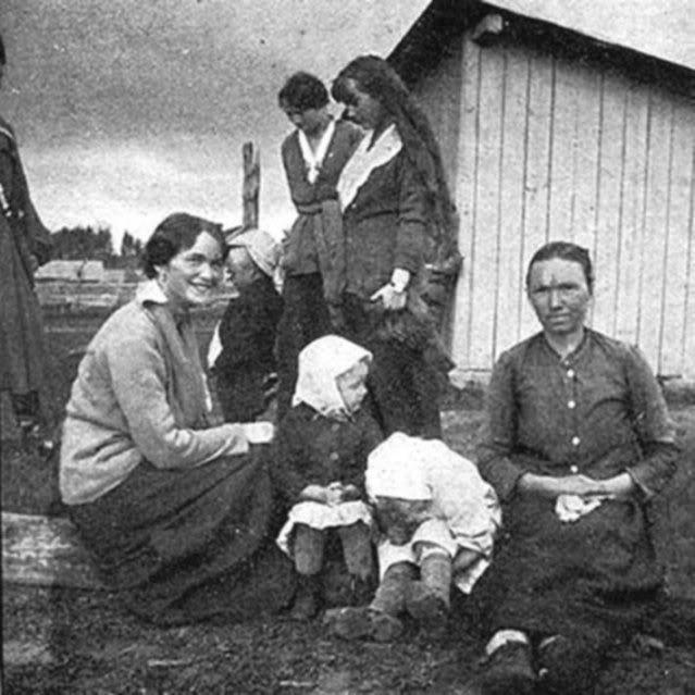 Grand Duchesses Olga, Tatiana and Anastasia with Russian families