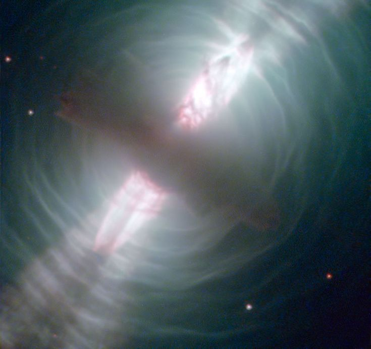 This Hubble image of the Egg Nebula shows one of the best views to date of this brief but dramatic phase in a stars life. The distance to the Egg Nebula is only known very approximately,around 3000 light-years from Earth. - Credit: ESA/Hubble and NASA via http://jean-baptiste-faure.blogspot.com/search/label/Protoplanetary%20Nebulae