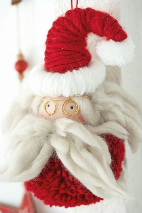 Make your Christmas tree extra special this year with this handmade Santa Claus pom-pom decoration.