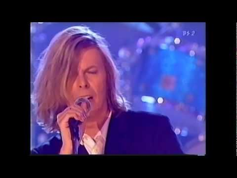(2000) David Bowie / This is not America ~ Absolute Beginners (2/5) Uploaded on Jun 16, 2011 David Bowie Live at the Beeb 2000 Category    Entertainment     License       Standard YouTube License