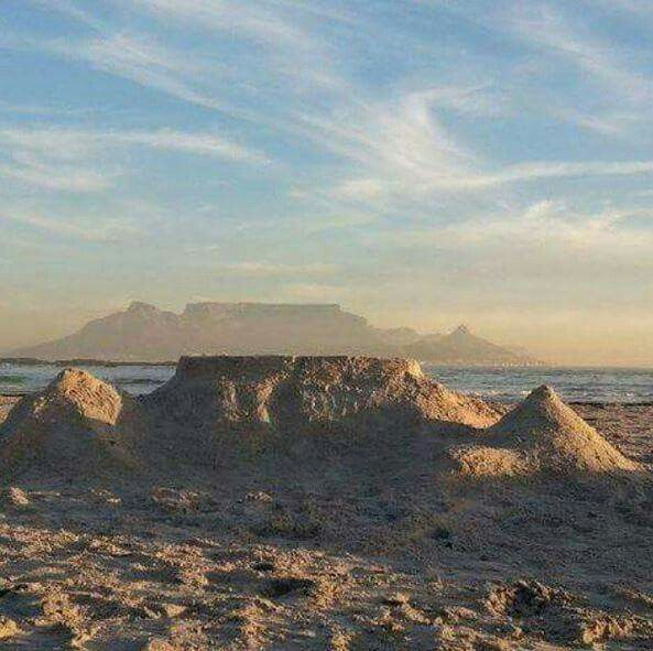 Table Mountain sand castle infront of the real thing