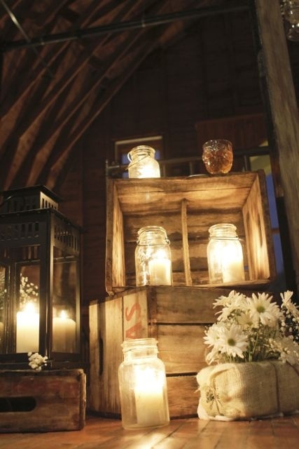 Crates and mason jars! The crates could be a nice stage decor for the ceremony filled with flowers! The mason jars could be used to serve drinks at the reception- could alos hold candies on the desert table and floating candles as centerpieces.