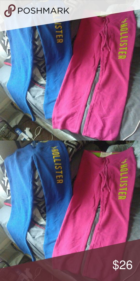 Bundle of hollister sweat pants..bundle Pair of pink hollister sweat pants with lime green logo going down the leg..a pair of blue sweat pants both are medium no flaws just dont fit me Hollister Pants Straight Leg
