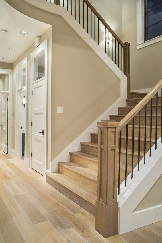 Mascord Plan 2472 - The Chatham: Love the white doors with glass above. Love the iron in the stair railing. We like the hardwood stairs, but it seems kind of dangerous.
