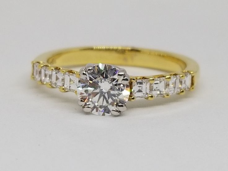 18 kt Yellow Gold diamond ring. Center diamond weighing 0,37ct  SI3 P EGL certified with  28 Diamonds totalling 0.30ct.
