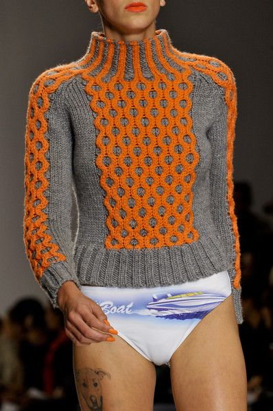 London Fashion Week Spring 2014. The sweater is awesome.... Not sure where her pants are though.