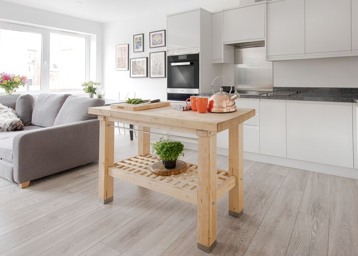 Professional chef and owner of Hardley Hill Farm, Sven-Hanson Britt, has embraced open plan living in his apartment, seen here featuring Miele appliances. His choice of a freestanding butcher's block in place of an island creates a feeling of space and provides much needed additional worktop space #kitchendesign
