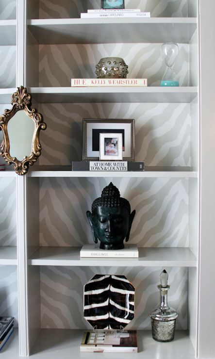 Lucy and Company - Gray built-ins with back of shelf lined with gray zebra wallpaper, ...