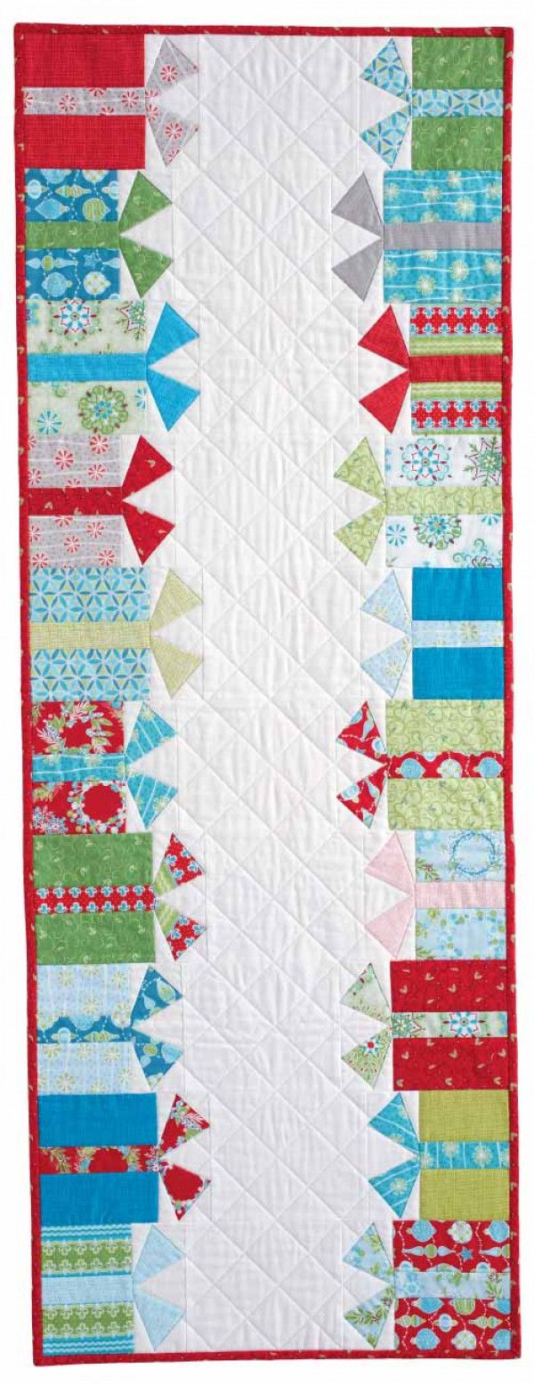 Make a holiday table runner with Jen Daly's design of rows of gift boxes, foundation and patch pieced.
